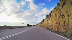 POV vehicle driving coastal local road sky point of view meditative car travel Stock Footage