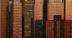 Futuristic looking New York City glass skyscrapers reflect the sky at dusk Stock Footage