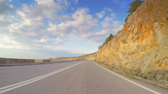 POV vehicle drive coastline sunny blue sky car twisting road point of view Stock Footage