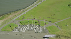 Helicopter aerial view of flags near Statue of Liberty Stock Footage