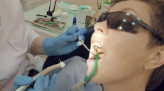 Woman at the dentist medical clinic for treatment Stock Footage