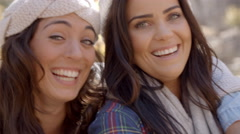 Head and shoulders shot of happy Lesbian couple in a forest Stock Footage