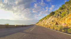Point of view vehicle driving road rocky coastline POV car travel blue sky sunny Stock Footage