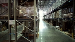 Camera moving before palettes with ordered goods and materials at warehouse Stock Footage
