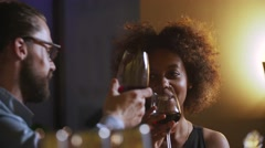 Young Couple Toasting Wine Glass In Luxury bar. Dating. Hipster and black woman Stock Footage