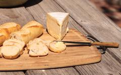 French bread and triple cream brie cheese Stock Photos