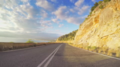 POV vehicle drive coastline rocky sunny blue sky clouds car road point of view Stock Footage