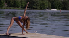 Yoga summertime model on dock in slow motion Stock Footage