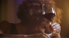 Close up beautiful sexy young black woman drinking red wine in bar. She's in a Stock Footage