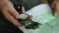Man Uses Navigational Compass Stock Footage