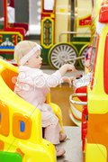 Sitting toddler on carousel Stock Photos