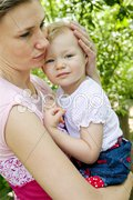 Portrait of mother with her little girl Stock Photos