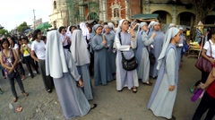 Nuns are gathered on churchyard before procession Stock Footage