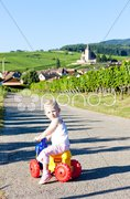 Little girl on toy motorcycle, Hunawihr, Alsace, France Stock Photos