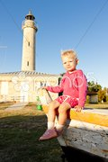 Sitting little girl, Richard Lighthouse, Aquitaine, France Stock Photos