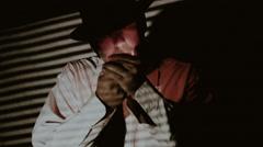 Man Lighting Cigarette Shadows Film Noir Stock Footage