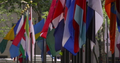 Multicolored flags of the world blow in the wind in slow motion Stock Footage