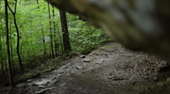 View of A Clear Rocky Area Under a Cliff Stock Footage