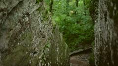 Pan Up of Textured Rock Face Stock Footage
