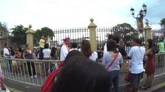 Bishop walking on sidewalk amidst crowd Stock Footage