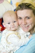 Portrait of mother with her baby Stock Photos