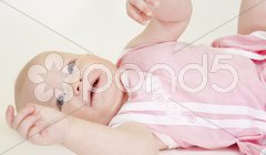 Portrait of lying down baby girl Stock Photos