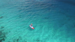 Bikini woman paddle boarding in the Virgin Islands Stock Footage