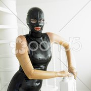 Portrait of woman in latex Stock Photos