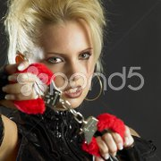 Woman's portrait with handcuffs Stock Photos
