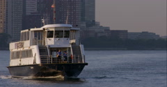 New York Waterway boat moves by in slow motion as ferry passes in the background Stock Footage