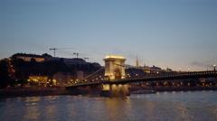 Illuminating Chain bridge at night - Budapest, Danube river, Hungary Stock Footage