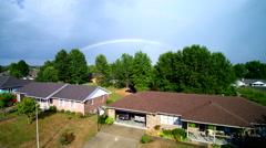 Fast jib like shot of gorgeous rainbow reveal Stock Footage