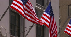 American Flags in New York City blowing in the breeze in slow motion Stock Footage