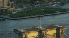 Aerial view of Brooklyn Bridge and American USA Flag at sunset New York City Stock Footage