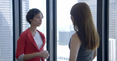 Mixed-race business woman talks to colleague in Downtown LA office 4K Stock Footage
