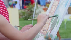 Painting It With Watercolors On Canvas Stock Footage