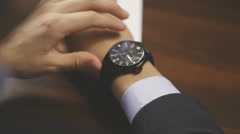 Businessman checking wrist watch. The watch on the hand Stock Footage