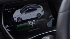 CLOSE UP: Instrument panel displays charging info when Tesla model S plugged in Stock Footage