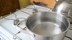 Water starts to boil in saucepan Stock Footage