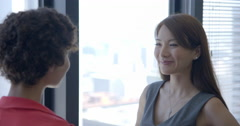 Asian business woman talks with colleague in Downtown LA office 4K Stock Footage