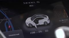 CLOSE UP: Information panel display in Tesla model S while recharging batteries Stock Footage