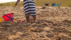 Cute boy playing in sand and buckets at beautiful ocean beach Stock Footage