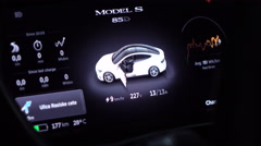 CLOSE UP: Information displayed on instrument panel when charging Tesla model S Stock Footage