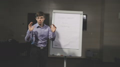 Young businessman giving an expressive presentation speech Stock Footage