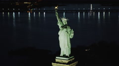 Helicopter aerial night view of  Statue of Liberty Stock Footage