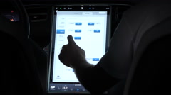 CLOSE UP: Setting controls and overview on touchscreen display in Tesla Model S Stock Footage