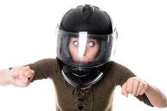 Woman with motorcycle helmet Stock Photos