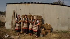 Women in National Ukrainian Costumes Around the Bale of Straw, Offering Bread, Stock Footage