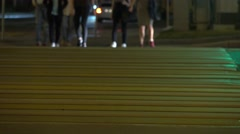 People crossing evening street. Traffic light and crosswalk. 4K shot Stock Footage