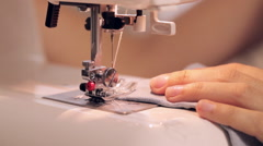 Close up footage of a woman sewing on sewing machine Stock Footage